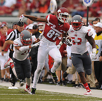 NWA Media/ANDY SHUPE - Arkansas receiver Kendrick Edwards (87) carries the ball as Nicholls defensive back Josh Singleton (21) during the fourth quarter Saturday, Sept. 6, 2014, at Razorback Stadium in Fayetteville
