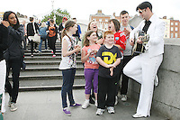 "NO REPRO FEE. 11/8/2010. Elvis Presley Story. Irelands foremost Elvis performer Kevin Doyle is pictured in his Elvis costume rehearsing on the Ha Penny Bridge Dublin with the Finnegan Family in preparation for his show "" Kevin Doyle Sings the Elvis Presley Story"" this Sunday the 15th of August at the Olympia Theatre. Tickets are from 25.50 including booking fee on sale now. Picture James Horan/Collins Photos"