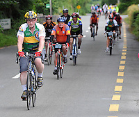 Taoiseach Enda Kenny freewheels into Kenmare after travelling over 100 miles on the annual Ring of Kerry Charity cycle. Photo: Don MacMonagle
