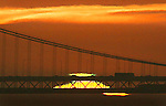 The appeared green flash as the sun rose over the Bay Bridge seen from Fort Baker in Sausalito, California.
