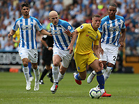 Chelsea's Ross Barkley battles with Huddersfield Town's Aaron Mooy (left) and Mathias Zanka Jorgensen (right) <br /> <br /> Photographer Stephen White/CameraSport<br /> <br /> The Premier League - Huddersfield Town v Chelsea - Saturday August 11th 2018 - The John Smith&rsquo;s Stadium<br />  - Huddersfield<br /> <br /> World Copyright &copy; 2018 CameraSport. All rights reserved. 43 Linden Ave. Countesthorpe. Leicester. England. LE8 5PG - Tel: +44 (0) 116 277 4147 - admin@camerasport.com - www.camerasport.com