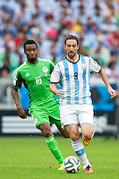 Gonzalo Higuain of Argentina and Mikel John Obi of Nigeria
