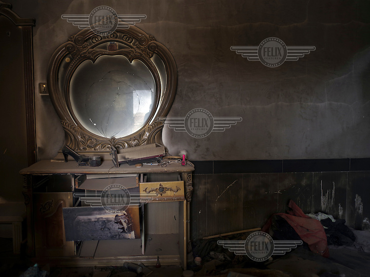 A broken dressing table in the bedroom of Rahad's old house in Bolleck village in Sinjar. Rahad and his family are Yazidis who fled the advance of ISIS in AUgust 2013.