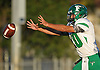 Tommy Donovan #10, Farmingdale quarterback, takes a snap during the first quarter of a Nassau County Conference I varsity football game against host Oceanside High School on Friday, Sept. 16, 2016.