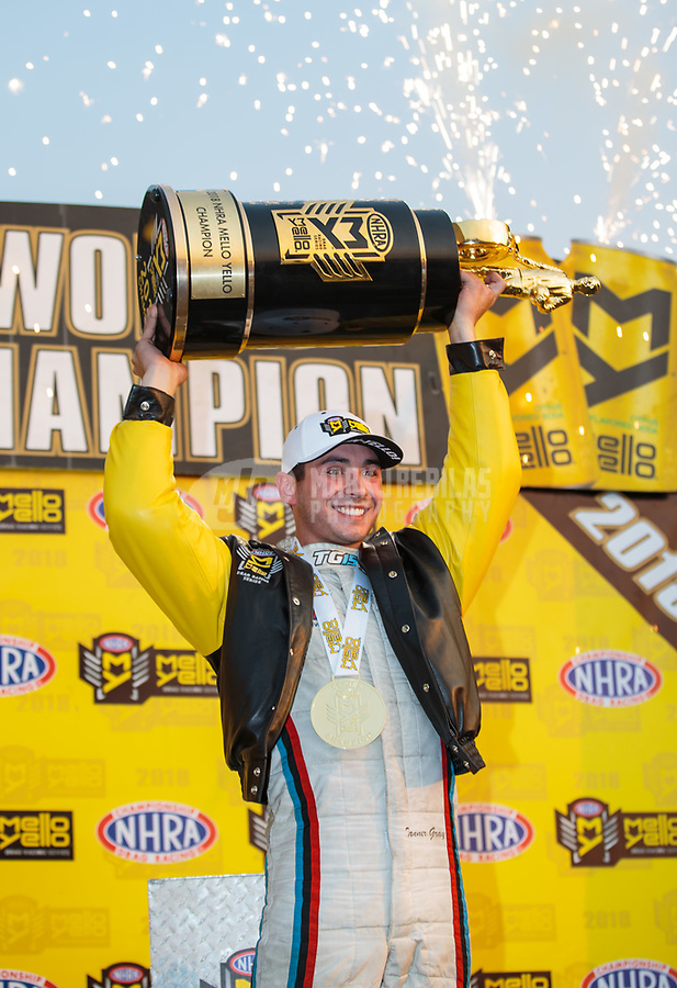 Nov 10, 2018; Pomona, CA, USA; NHRA pro stock driver Tanner Gray celebrates after clinching the 2018 pro stock world championship during qualifying for the Auto Club Finals at Auto Club Raceway. Mandatory Credit: Mark J. Rebilas-USA TODAY Sports