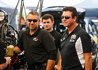 Oct 15, 2016; Ennis, TX, USA; Papa Johns Pizza owner John Schnatter with crew member for NHRA top fuel driver Leah Pritchett during qualifying for the Fall Nationals at Texas Motorplex. Mandatory Credit: Mark J. Rebilas-USA TODAY Sports