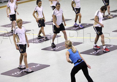 20 04 2011. Cologne, Germany. Ladies International Football.   Fitness Instructor Gives instructions during The The Coordinated athletics training session  of The German Women National team