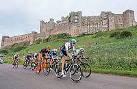 Picture by Allan McKenzie/SWpix.com - 04/09/2017 - Cycling - OVO Energy Tour of Britain - Stage 2 Kielder Water to Blyth - The breakaway passes in front of Bamburgh Castle.