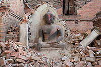 A Buddha statue stands in the rubbles at Bhaktapur, near Kathmandu, Nepal.  May 03, 2015