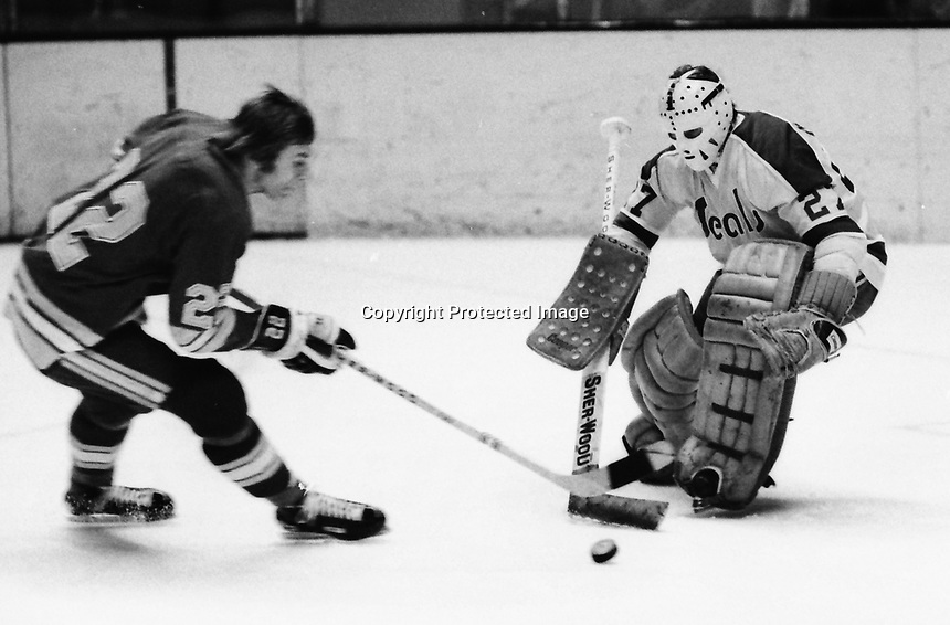 Pittsburg Penguin #22 Danny O'Shea tries to score on Seals goalie Gilles Meloche. (1972 photo/by Ron Riesterer)