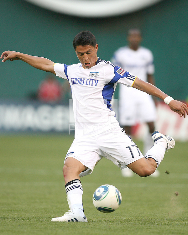 Roger Espinoza #17 of the Kansas City Wizards takes a shot during an MLS match against D.C. United at RFK Stadium on May 5 2010, in Washington DC. United won 2-1