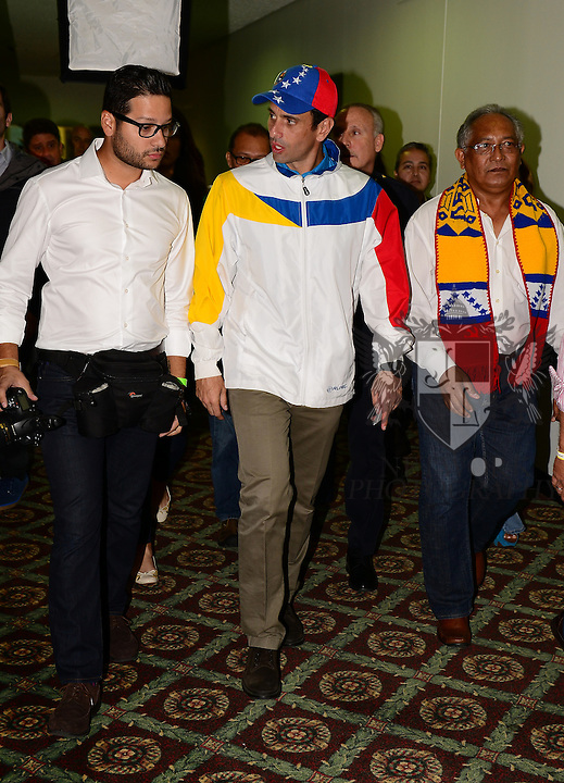 "Venezuelan opposition leader Henrique Capriles leaving after a press conference after speaks during his first public presentation in Miami and in the U.S., a lecture on ""The Struggle for Democracy."" The event is co-presented with the Mesa de la Unidad and the Red Democrática Internacional hosted by Miami Dade College at the James L. Knight Center in downtown in Miami, Florida on September 15, 2013. (Photo by Johnny Louis/jlnphotography.com)"