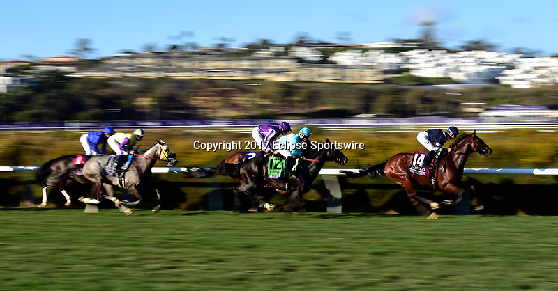 DEL MAR, CA - NOVEMBER 04: The horses blur down the track during the Longines Breeders' Cup Turf race on Day 2 of the 2017 Breeders' Cup World Championships at Del Mar Racing Club on November 4, 2017 in Del Mar, California. (Photo by Jamey Price/Eclipse Sportswire/Breeders Cup)