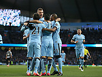 Sergio Aguero of Manchester City is mobbed as he  celebrates scoring his goal - Barclays Premier League - Manchester City vs Newcastle Utd - Etihad Stadium - Manchester - England - 21st February 2015 - Picture Simon Bellis/Sportimage