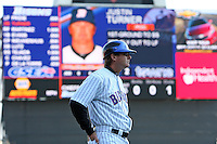 Buffalo Bisons manager Tim Teufel #11 with the new scoreboard during a game against the Syracuse Chiefs at Dunn Tire Park on April 7, 2011 in Buffalo, New York.  Syracuse defeated Buffalo 8-5.  Photo By Mike Janes/Four Seam Images