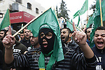 Palestinian supporters of the Islamist movement Hamas gesture and wave the movement's flag during a demonstration in the West Bank city of Hebron on November 23, 2012. Photo by Mamoun Wazwaz