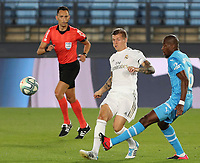 18th June 2020, Alfredo Di Stefano Stadium, Madrid, Spain; La Liga football, Real Madrid versus Valencia;  Real Madrids Toni Krocrosses ahead of Valencias Geoffrey Kondogbia