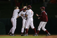 STANFORD, CA - FEBRUARY 20:  Outfielder Toby Gerhart #24 (second from left) is congratulated by catcher Zach Jones #5 (far left), infielder J.J. Jelmini #3 of the Stanford Cardinal during Stanford's 6-1 season opener win against the Vanderbilt Commodores on February 20, 2009 at Sunken Diamond in Stanford, California.