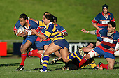 Alesio Petelo tries to break through the tackle of Male Sau'.McNamara Cup final - Premier 1 Championship, Patumahoe v Ardmore Marist. Patumahoe won 13 - 6. Counties Manukau club rugby finals played at Growers Stadium, Pukekohe, 24th of June 2006.