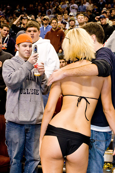A fan takes a picture with Amanda Vanderziel, &quot;Miss WIP&quot;, at the 14th annual Wing Bowl, held in Philadelphia on February 3, 2006 at the Wachovia Center.<br /> <br /> The Wing Bowl is a competitive eating event in which eaters try and down the most hot wings in 30 total minutes in front of a crowd of 10,000 plus people.  The real show however is all around the eaters, from the various scantily clad women (known as &quot;Wingettes&quot;) that make up eaters' entourages, to the behavior of the fans themselves.