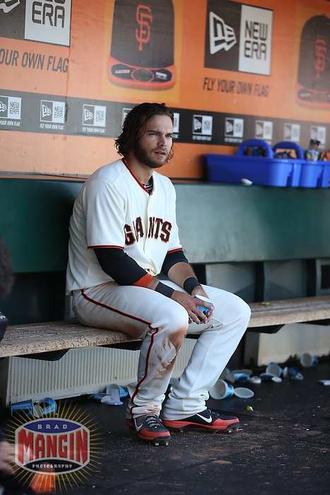 SAN FRANCISCO, CA - JUNE 12:  Brandon Crawford of the San Francisco Giants sits in the dugout during the game against the Washington Nationals at AT&T Park on Thursday, June 12, 2014 in San Francisco, California. Photo by Brad Mangin