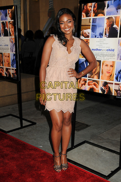 "TATYANA ALI.""Mother and Child"" Los Angeles Premiere held at Grauman's Egyptian Theatre, Hollywood, California, USA..April 19th, 2010.full length beige sleeveless dress hand on hip lace pink cream.CAP/ADM/BP.©Byron Purvis/AdMedia/Capital Pictures."