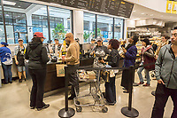 Customers buy coffee and other beverages in the new Whole Foods Market in Newark, NJ on opening day Wednesday, March 1, 2017. The store is the chain's 17th store to open in New Jersey. The 29,000 square foot store located in the redeveloped former Hahne & Co. department store building is seen as a harbinger of the revitalization of Newark which never fully recovered from the riots in the 1960's.  (© Richard B. Levine)