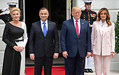 United States President Donald J. Trump, right center, and first lady Melania Trump, right, President Andrzej Duda of the Republic of Poland, left center, and his wife, Agata Kornhauser-Duda, left, pose for a group photo as they are welcomed to the South Lawn of the White House in Washington, DC on Wednesday, June 12, 2019. <br /> Credit: Ron Sachs / CNP