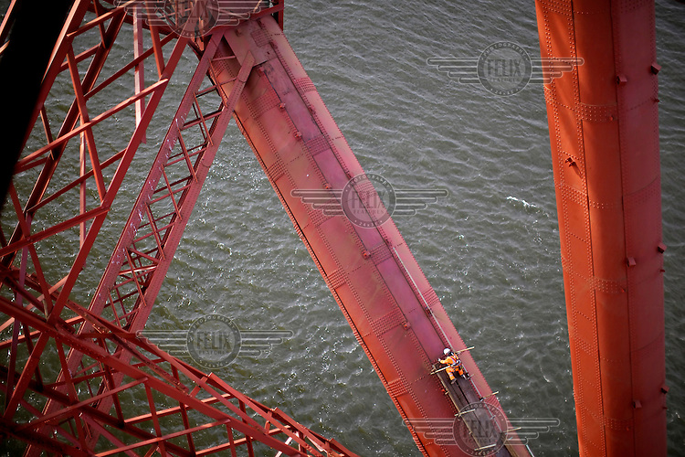 While the majority of workers were able to access the bridge using scaffolding, a team of abseilers was employed throughout to undertake work in hard to reach locations on the 125 year old Forth Rail Bridge which spans the river Forth near Edinburgh. Network Rail, the operator of the rail track that leads over the bridge, has spent 10 years and GBP 130 million repainting the 230,000 square metres of steel and 6.5 million rivets on the bridge. The iconic red paint used on the bridge is made to match the red-oxide paint used over 100 years ago. The bridge will now need no further painting for at least 20 years.