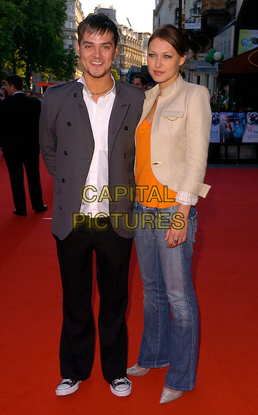 "MATT WILLIS & EMMA GRIFFITHS.The ""Just My Luck"" UK premiere at Vue West End, London, UK..June 28th, 2006.Ref: CAN.full length grey gray jacket beige jeans denim couple.www.capitalpictures.com.sales@capitalpictures.com.©Capital Pictures"
