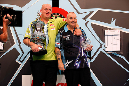 24.07.2016. Empress Ballroom, Blackpool, England. BetVictor World Matchplay Darts. Michael van Gerwen with the winners trophy with Phil Taylor