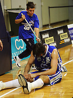 Kevin Owens slumps after a collision during the NBL Basketball match between the Wellington Saints and Bay Hawks, TSB Bank Arena, Wellington, New Zealand on Saturday, 10 May 2008. Photo: Dave Lintott / lintottphoto.co.nz