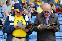 Oxford United fans enjoy reading the match day programme before kick off<br /> <br /> Photographer David Shipman/CameraSport<br /> <br /> The EFL Sky Bet League One - Oxford United v Fleetwood Town - Saturday August 11th 2018 - Kassam Stadium - Oxford<br /> <br /> World Copyright &copy; 2018 CameraSport. All rights reserved. 43 Linden Ave. Countesthorpe. Leicester. England. LE8 5PG - Tel: +44 (0) 116 277 4147 - admin@camerasport.com - www.camerasport.com