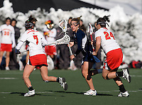 Mary Flowers (11) of Richmond tries to find a way past Katie Schwarzman (7) and Katie Gallagher (24) of Maryland at the practice turf field in College Park, Maryland.  Maryland defeated Richmond, 17-7.