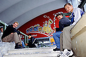 Sarajevo, Bosnia. Youths hanging around at the station with mural of a cartoon train.