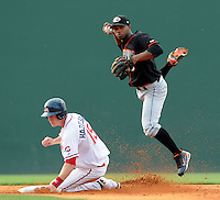 July 25, 2009: Delmarva Shorebirds shortstop Rodolfo Cardona (6) makes the putout at second on Jeremy Hazelbaker (15) of the Greenville Drive but can't get the ball to first in time for a double play in a game at Fluor Field at the West End in Greenville, S.C. Photo by: Tom Priddy/Four Seam Images