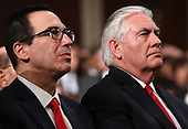 WASHINGTON, DC - JANUARY 30:  Treasury Secretary Steven Mnuchin (L) and U.S. Secretary of State Rex Tillerson listen to President Trump's State of the Union address in the chamber of the U.S. House of Representatives January 30, 2018 in Washington, DC. This is the first State of the Union address given by U.S. President Donald Trump and his second joint-session address to Congress.  <br /> Credit: Win McNamee / Pool via CNP