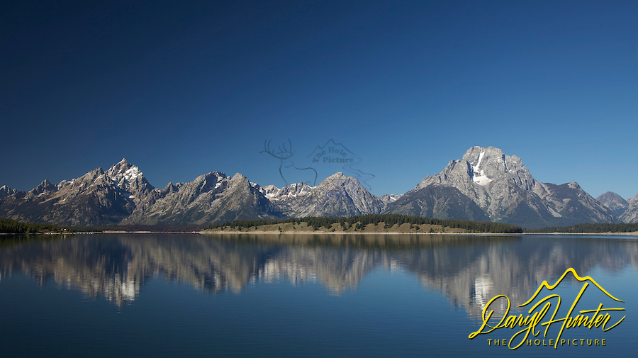 Grand Teton Reflections in the water of Jackson Lake in Grand Teton National Park.