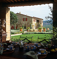 View from the loggia over the garden to a restored stone villa in the grounds of the estate