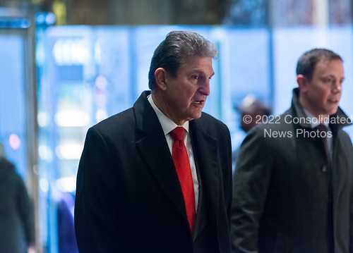 United States Senator Joe Manchin (Democrat of West Virginia) is seen in the lobby of Trump Tower in New York, NY, USA upon his arrival for a meeting with President-elect Trump on December 12, 2016. <br /> Credit: Albin Lohr-Jones / Pool via CNP