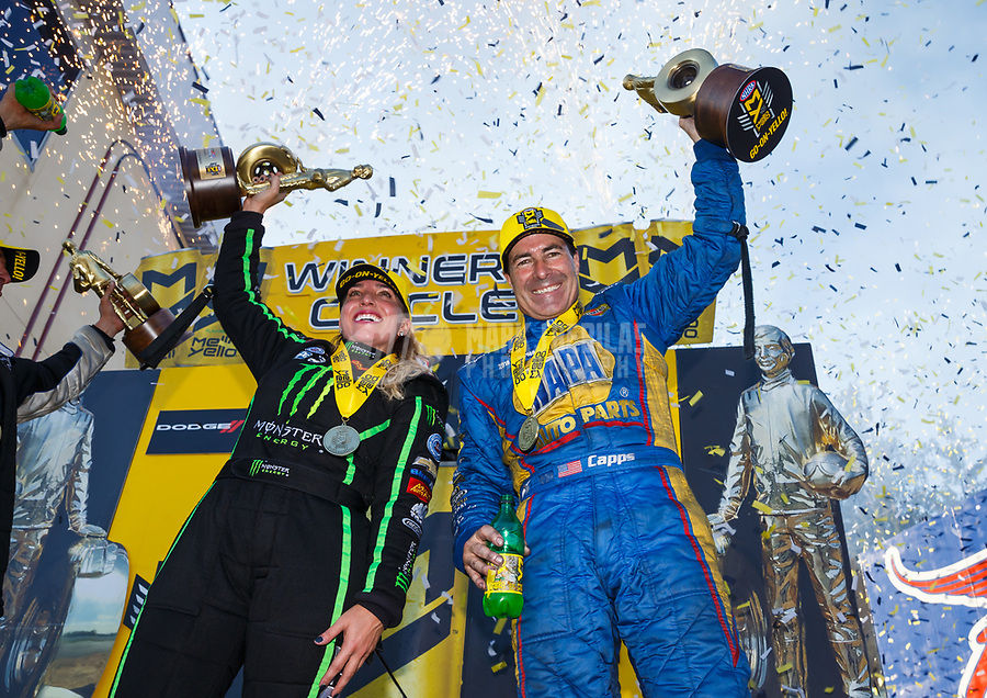 Sep 24, 2017; Mohnton, PA, USA; NHRA funny car driver Ron Capps (right) and top fuel driver Brittany Force celebrate after winning the Dodge Nationals at Maple Grove Raceway. Mandatory Credit: Mark J. Rebilas-USA TODAY Sports