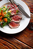 USA, California, Oakland, Chop Bar, Seared Spring Lamb Loin, Pea Shoots, Baby Carrots, Olive Oil
