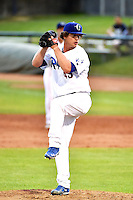 Grant Holmes (45) of the Ogden Raptors delivers a pitch to the plate against the Orem Owlz in Pioneer League action at Lindquist Field on August 20, 2014 in Ogden, Utah.  (Stephen Smith/Four Seam Images)