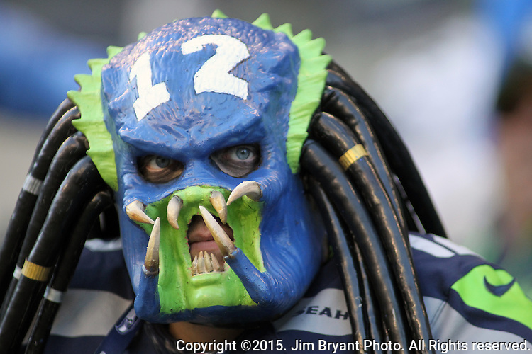 Seattle Seahawks fan, dressed as the Predator watches the game against the San Francisco 49ers at CenturyLink Field in Seattle, Washington on November 22, 2015.  The Seahawks beat the 49ers 29-13.   ©2015. Jim Bryant Photo. All RIghts Reserved.
