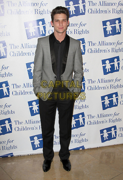 DARREN KAGASOFF .Attending The Alliance for Children's Rights held At The Beverly Hilton Hotel, Beverly Hills, California, USA,.10th February 2010..full length black shirt grey gray suit jacket hands in pockets .CAP/ADM/KB. ©Kevan Brooks/AdMedia/Capital Pictures..