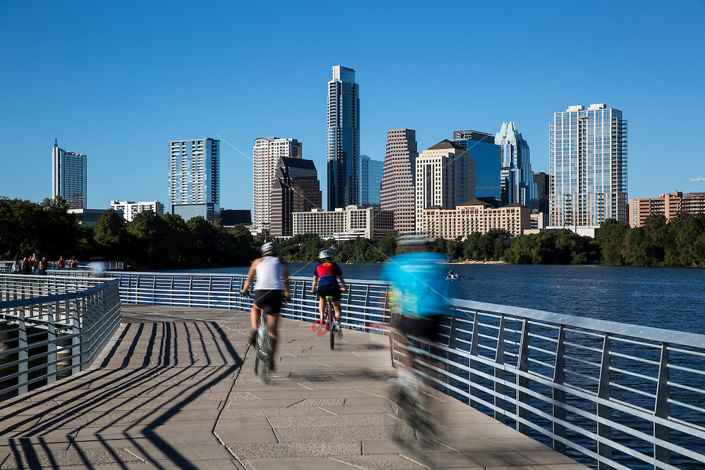 A team of cyclist ride on the Boardwalk Trail at Lady Bird Lake, Austin's new favorite trail for biking and running and marathon and half marathon training.