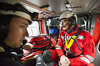 "Switzerland. Canton Ticino. Osogna Bresciano. A Rega Agusta AW109 SP Grand ""Da Vinci"" helicopter with Massimo Gaggetta (L), a helicopter rescue specialist for canyoning emergencies, and the Doctor Michele Musiari (R). All Rega helicopters carry a crew of three: a pilot, an emergency physician, and a paramedic who is also trained to assist the pilot for radio communication, navigation, terrain/object avoidance, and winch operations. The name Rega was created by combining letters from the name ""Swiss Air Rescue Guard"" as it was written in German (Schweizerische Rettungsflugwacht), French (Garde Aérienne Suisse de Sauvetage), and Italian (Guardia Aerea Svizzera di Soccorso). Rega is a private, non-profit air rescue service that provides emergency medical assistance in Switzerland. Rega mainly assists with mountain rescues, though it will also operate in other terrains when needed, most notably during life-threatening emergencies. As a non-profit foundation, Rega does not receive financial assistance from any government. The AgustaWestland AW109 is a lightweight, twin-engine, helicopter built by the Italian manufacturer Leonardo S.p.A. (formerly AgustaWestland, Leonardo-Finmeccanica and Finmeccanica). Leonardo S.p.A is an Italian global high-tech company and one of the key players in aerospace. In close collaboration with the manufacturer, the Da Vinci has been specially designed to cater for Rega's particular requirements as regards carrying out operations in the mountains. It optimally fulfills the high demands made of it in terms of flying characteristics, emergency medical equipment and maintenance. Safety, performance and space have been increased, and maintenance and noise emissions reduced. 9.09.2017 © 2017 Didier Ruef"
