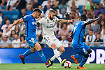 Karim Benzema (C) of Real Madrid fights for the ball with Mauro Wilney Arambarri Rosa (L) and Dakonam Ortega Djene of Getafe CF during the La Liga 2018-19 match between Real Madrid and Getafe CF at Estadio Santiago Bernabeu on August 19 2018 in Madrid, Spain. Photo by Diego Souto / Power Sport Images
