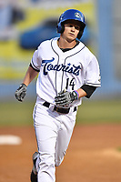 Asheville Tourists center fielder Eric Toole (14) rounds the bases after hitting a home run during a game against the West Virginia Power at McCormick Field on May 10, 2017 in Asheville, North Carolina. The Tourists defeated the Power 4-3. (Tony Farlow/Four Seam Images)