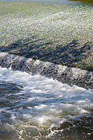 Weir and flowing water on River Duero in Castile and Leon, Spain